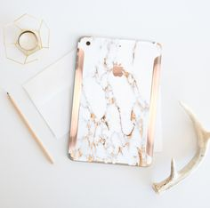 Platinum Edition Bianco Sivec Gold Veins with Rose Gold/Copper Detailing Vinyl Skin for the iPad Air 2, iPad mini 4 , iPad Pro by Cliqueshops on Etsy https://www.etsy.com/listing/275284336/platinum-edition-bianco-sivec-gold-veins