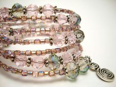 Memory Wire Bracelet, Light Pink and Purple Crystal Beaded Bracelet, Silver Wire Wrap Bracelet. $55.00, via Etsy.