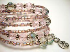Memory Wire Bracelet, Light Pink and Purple Crystal Beaded Bracelet, Silver Wire Wrap Bracelet. $55.00, via Etsy.