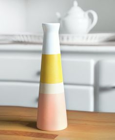 The colorful ceramic vase is an unique way to give any living or working space a modern and fresh feel.    - made of white ceramic  - painted in