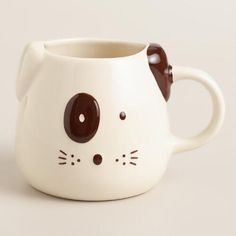 The perfect gift for animal lovers, our stoneware coffee mug features a two-tone dog design with folded ears, perky whiskers and a spotted eye.