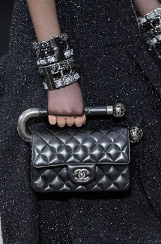 Chanel Fall 2013  (This bag reminds me of H. R. Giger or something a Tim Burton film extra would wear.) #fashion