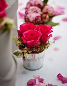 Seriously easy DIY #Wedding floral: Petite roses in galvanized buckets.  Use floral foam, some moss, some greens and your favorite flower or flowers.  Dress it up with a paper wrap, a ribbon, a tag with your message to your guests... so easy to personalize this one!