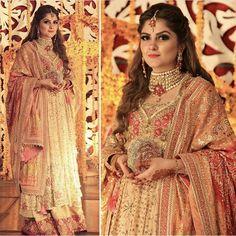 Rabia Waheed looking beautiful in a traditional #FarahTalibAziz kalidaar Peshwas featuring shades of TeaRose pink, Coral, Magenta and Golds. #FTAWeddingWear