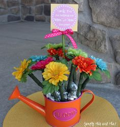 watering can filled with kisses. add handmade flower pens and printable tag! from simply this and that