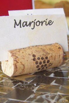 Make place card holders. | 37 Insanely Creative Things To Do With Popped Corks