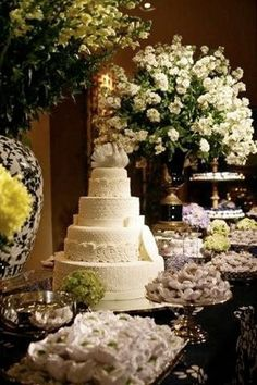 white wedding cake table - I would marry just to have this arrangement hi hi - love it!!!!