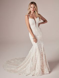 25174 - Alma - This lace mermaid wedding dress makes us feel like spring has arrived. So whatever your nuptials season, please think of crocuses and lilacs in the bright May air.  Try this beauty on at Aurora Bridal in Melbourne, FL 321-254-3880