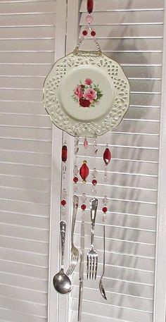 Upcycle plate and silverware to make pretty windchime - #shabby #chic #upcycle #repurpose #china #silverware #crafts #DIY (inspiration only)