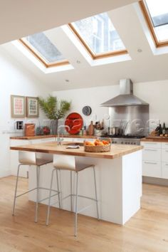 Velux windows above bar stools at breakfast bar in contemporary kitchen for my house :) breakfast and sunrise! Open Plan Kitchen, New Kitchen, Kitchen Dining, Kitchen Island, Kitchen Cabinets, Diy Roofing, Steel Roofing, Roofing Shingles, Roof Decoration