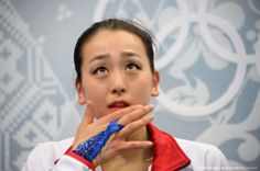 Japan's Mao Asada reacts in the kiss and cry zone in the Women's Figure Skating Free Program at the Iceberg Skating Palace during the Sochi Winter Olympics on February 20, 2014. AFP PHOTO / DAMIEN MEYER (1538×1023)