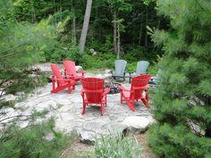 Muskoka chairs around the campfire