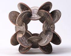 Interlocked Coins Form Complex Geometric Sculptures - My Modern Metropolis