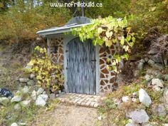 Earth Shelter Root Cellar with Cordwood Walls and a Living Roof