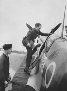 Bader swings one of his prosthetic legs into the cockpit of a Supermarine Spitfire fighter in September 1945. After being liberated from a German prison, Bader returned to duty and led a flight of Spitfires from North Weald Airfield in a flyover of London commemorating the fifth anniversary of the Battle of Britain.