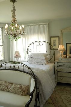 This room is a gorgeous representation of a vintage garden bedroom or guest bedroom. I can only imaging the great garden landscape just outside those windows. All the circular metalwork in this bedroo Cottage Chic, Country Cottage Bedroom, French Country Bedrooms, Cottage Style, Romantic Cottage, Romantic Getaway, Cottage Bedrooms, Romantic Homes, Farmhouse Bedrooms