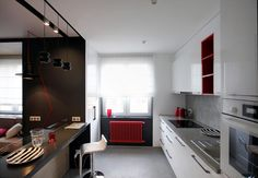 open-space-kitchen-small-apartment-red-radiator - Home Decorating Trends - Homedit Colorful Apartment, White Apartment, Small Apartments, Small Spaces, Kitchen Interior, Kitchen Design, Space Kitchen, Kitchen Small, Interior Desing