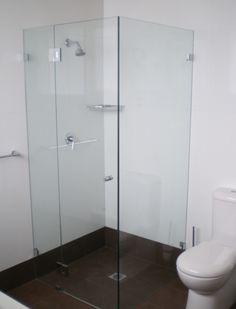 custom made frameless hinged shower screen by White Bathroom Co