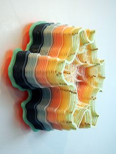 Hand Cut Paper Microorganisms by Tennessee-based artist Charles Clary - he knows a thing or two about patience as evidenced by his structural paper creations reminiscent of biological formations or topographical maps. In creating a new piece Clary can work for up to 12 hours a day cutting each thin layer in his delicately stacked sculptures that arise from gallery walls or descend into geometric volumes @thisiscolossal.com or see more of his work on his website.(via Hi-Fructose)<3
