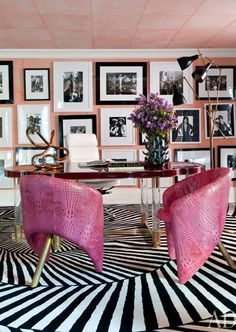 Kelly Wearstler- a perfect peachy wall color for you. Love it mixed with the pink chairs.