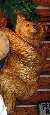 a must a wood carved bear