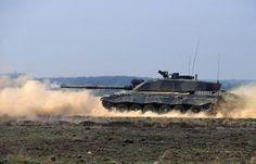 AChallenger 2 tank firing on the move.