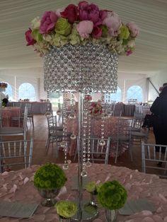 Magnificent floral arrangement for a pink graduation tent party!