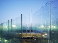 'AUDI haus' by atelier FCJZ at international racing circuit, shanghai the layers of glass are combined to create a translucent atmosphere lights from under the glass is refracted, creating thin, glowing edges Chinese Architecture, Gothic Architecture, Architecture Details, Exhibition Booth, Pavilion, Event Design, Cool Photos, Exterior, Building
