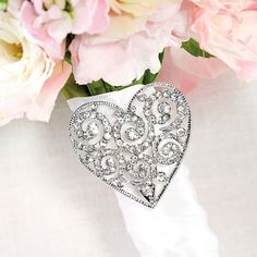 Bouquet Buckle from Exclusively Weddings on shop.CatalogSpree.com, your personal digital mall.