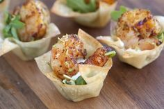 Chili Lime Shrimp Cups You'll love these. Wonton shells are baked in the oven (so easy) then are filled with a few arugula leaves and sour cream THEN are topped with a chili lime shrimp. It's one-bite madness, I tell ya, one-bite madness!