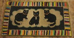 A hooked rug of wool fabric on burlap featuring three kittens in the center with a colorful striped border. Circa 1930s. Dimensions: 19 1/4 x 34 inches. In very nice condition.    PRICE: $850