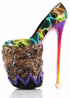 "At the recent opening of the Chris Ofili Retrospective at the Tate Britain a collective of young British artists were asked to create art inspired by the exhibition. Shoe designer INSA created this fab pair of 10"" heels by incorporating Ofili's signature elements - beadwork, elephant dung, and hot, bright color & pattern!!!!!"