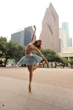 Downtown in front of the Wortham Theater. Houston, Texas. Photo by: Sarah Carter ♥ Wonderful! www.thewonderfulworldofdance.com #ballet #dance