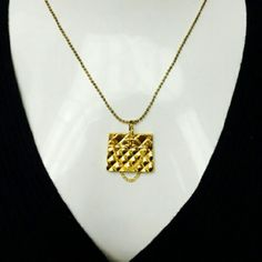 Authentic CHANEL Gold Tone Quilted Purse Pendant ABSOLUTELY BEAUTIFUL! LAST ONE- Authentic CHANEL Gold Tone Quilted Purse Pendant. COMES AS IS WITH OUT CHAIN, BEZEL LARGE enough to fit any necklace or cord. Bold & GORGEOUS! CC on front, clearly stamped CHANEL on backside. CHANEL Jewelry