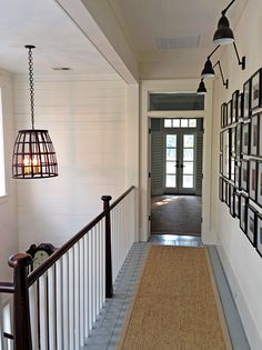 hallway photo gallery with lights.