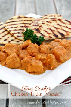 Slow Cooker Chicken Tikka Masala.  Use evap milk instead of cream and 1 tsp cayenne. Add veggies (carrot, bell pepper).  Cook no more than 4 hrs on hi.