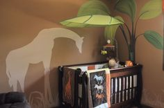Full picture of giraffe mural and tree mural, leave canopy over bed