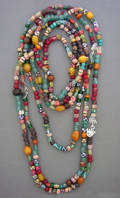 """Anna Holland ~ """"Riot of Colour"""".  Wide assortment of beads; Crow's eye, antique white hearts; Venetian melon beads, recycled powder glass beads from Ghana; and faux amber and horn beads from Ethiopia."""