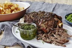 Spanish slow roasted lamb with rosemary and anchovy, duck fat potatoes and salsa verde