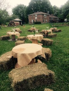 Wire spool tables with burlap, hay bale seating, green mason jars with white flowers for center pieces ** our vases were a little top heavy with the flowers & wind, make sure you have some heavier rocks to fill the bottom of the vases, we also stapled a couple of sides of the burlap to the spools