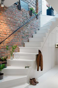 Stairs, hallway, exposed brick wall, white interiors, simplistic, minimal