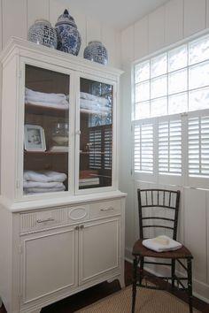 large cabinet in bathroom with blue ginger jars - lauren leonard