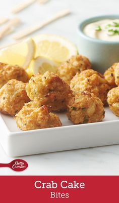 Crab Cake Bites These appetizer bites are a mini way to enjoy crab cakes for your next gathering. Crab, fresh chives and spices are folded into bread crumbs, shaped and baked for the perfect bite. Serve with lemon-garlic sauce for dipping. Crab Cake Recipes, Fish Recipes, Seafood Recipes, Cooking Recipes, Potato Recipes, Vegetable Recipes, Vegetarian Recipes, Recipies, Snacks Für Party
