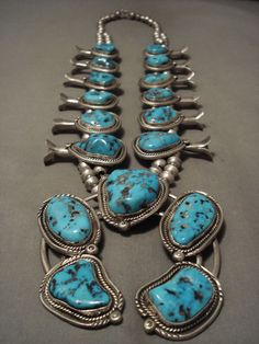 "These turquoise stones are gigantic and appear to be old Sleeping Beauty or Old Kingman turquoise. Check out the marvelous plethora of handmade silver beads. The largest turquoise stone which is placed on the 3-1/4"" X 3-1/8"" silver naja measures around 1"" X 1"". 