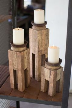 "Square Recycled Wood Candle Holders Set/3 Distinctive home & garden decorative accessories and accents. Dimensions:large 4"""" x 4"""" x 17""""tmedium 4"""" x 4"""" x 13""""tsmall 4"""" x 4"""" x 9""""t Usually ships w"