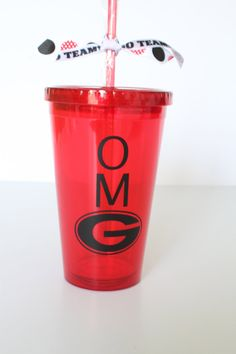 University of Georgia. OMG with UGA G. UGA Red insulated tumbler with black writing. Personalize with name monogram.. $12.50, via Etsy.