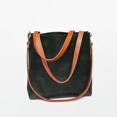 Minimal, distressed leather tote made of high quality vegetable tanned eco leather. The surface is mat giving it a striking robust look. One inner slip