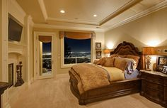 Custom designed bedroom with tray ceiling view of city lights