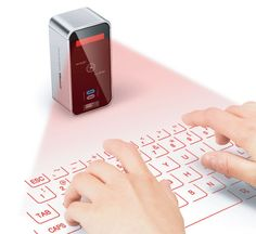 Celluon Magic Cube Laser Projection Keyboard, Virtual Portable Keyboard, motion detection technology, future gadget, future device, futuristic gadget, futuristic device