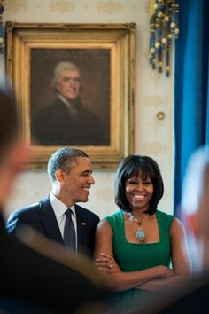 President Barack Obama and First Lady Michelle Obama stand together in the Blue Room of the White House, before a brunch celebrating the Inauguration, Jan. 18, 2013.
